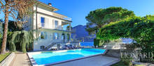 luxury villa with swimming pool by lake como