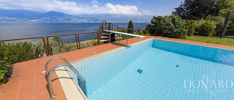 luxury villa with swimming pool overlooking lake garda